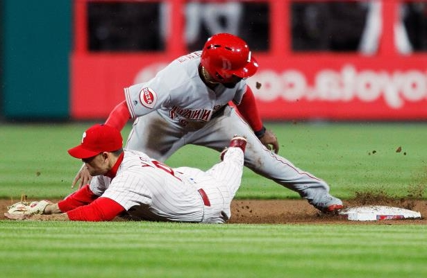 Slide 10 of 77: Cincinnati Reds' Phillip Ervin, top, is safe at second base after dodging the tag of Philadelphia Phillies' Scott Kingery, bottom, during the sixth inning of a baseball game Monday, April 9, 2018, in Philadelphia, Pa. (AP Photo/Tom Mihalek)