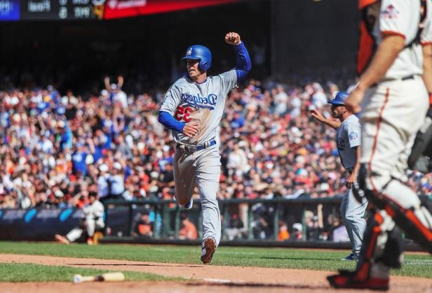 Slide 13 of 77: Apr 8, 2018; San Francisco, CA, USA; Los Angeles Dodgers first baseman Cody Bellinger (35) celebrates as he scores during the tenth inning against the San Francisco Giants at AT&T Park. Mandatory Credit: Sergio Estrada-USA TODAY Sports - 10777068