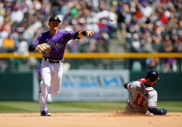 Slide 15 of 77: DENVER, CO - APRIL 08: Colorado Rockies infielder Trevor Story (27) turns a double play as Atlanta Braves Outfielder Ender Inciarte (11) slides into second base during a regular season MLB game between the Colorado Rockies and the visiting Atlanta Braves on April 8, 2018 at Coors Field in Denver, CO. (Photo by Russell Lansford/Icon Sportswire via Getty Images)