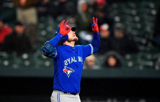 Slide 2 of 77: Toronto Blue Jays' Josh Donaldson celebrates his grand slam during the ninth inning of a baseball game against the Baltimore Orioles, Monday, April 9, 2018, in Baltimore. The Blue Jays won 7-1. (AP Photo/Nick Wass)