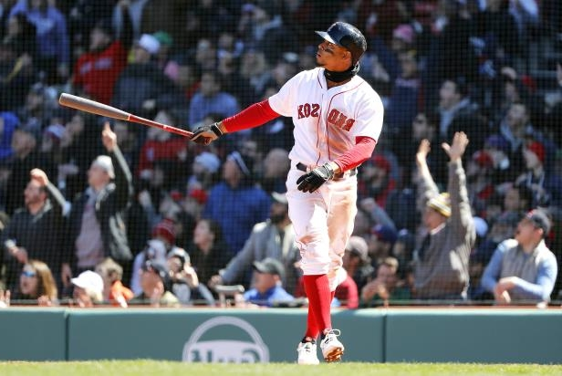 Slide 37 of 77: Boston Red Sox's Xander Bogaerts watches his grand slam during the second inning of a baseball game against the Tampa Bay Rays at Fenway Park in Boston, Saturday, April 7.