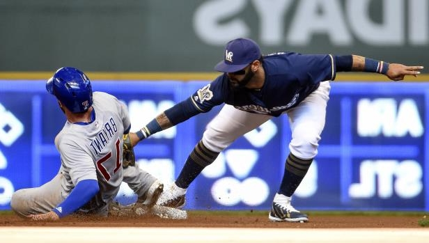 Slide 38 of 77: Milwaukee Brewers second baseman Jonathan Villar (5) tags out Chicago Cubs third baseman Kris Bryant (17) trying to steal second base in the fourth inning on April 7 in Milwaukee, WI.