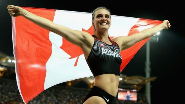 Canada's Alysha Newman celebrates after winning gold in the women's pole vault and setting a new Commonwealth Games record.