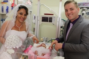 Couple marries in the NICU, beside preemie daughter's crib
