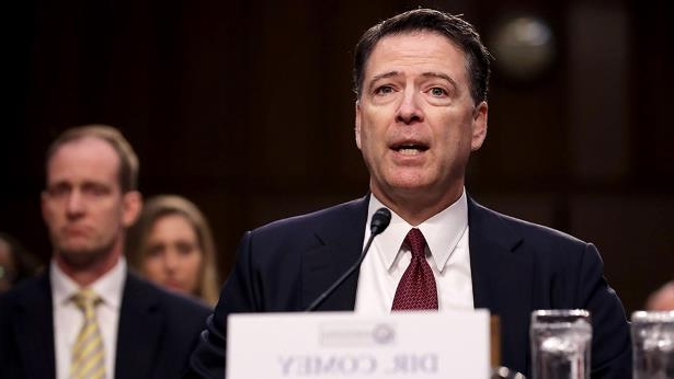 James Comey wearing a suit and tie