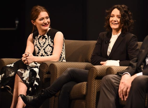 Sara Gilbert, Emma Kenney sitting posing for the camera