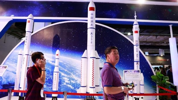Visitors walk past replicas of space rockets on display at the China Beijing International High-Tech Expo (CHITEC) in Beijing, China, 08 June 2017. The 20th edition of the China Beijing International High-Tech Expo opens 08 June with the theme of 'Technology Leading Integrated Innovation', and will run till 10 June.