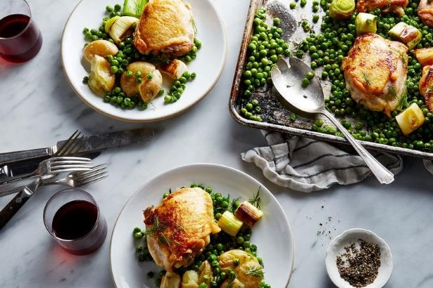 a bunch of food on a plate: Nigella Lawson's Chicken and Pea Traybake