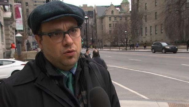 a man with a hat on a city street: Stefan Popovic, who lives and works on Sherbrooke St., filed a complaint with the STM about the bus driver's behaviour.