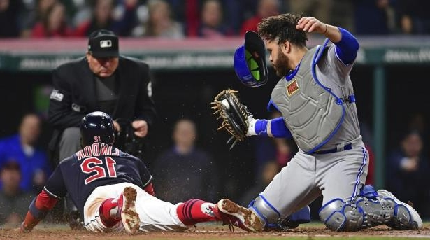 Jays catcher Russell Martin tags out Cleveland's Francisco Lindor, trying to score from second on a single in the sixth inning of Friday night's game.