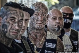 a group of people wearing costumes: A police plea to draw up a truce between the rival gangs in New South Wales was shot down by gang members
