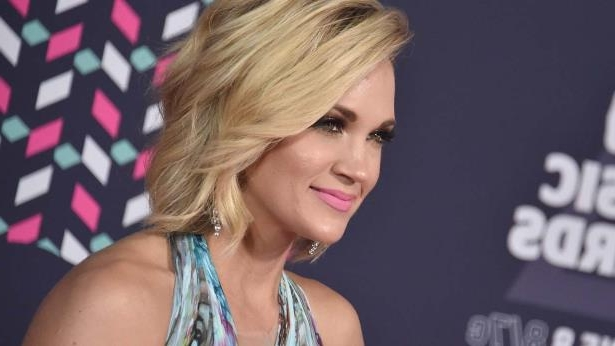 Carrie Underwood wearing a hat