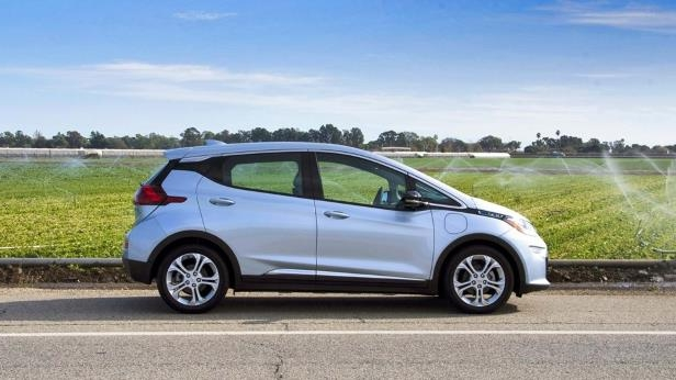 a car parked on the side of a road: 2017 Chevrolet Bolt EV-05-LW.jpg