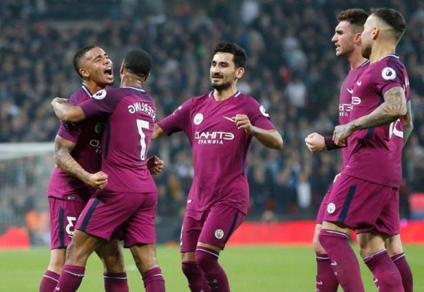 a group of young men playing a game of football: Manchester City secured the Premier League title after rival Manchester United lost to West Bromwich Albion on Sunday.
