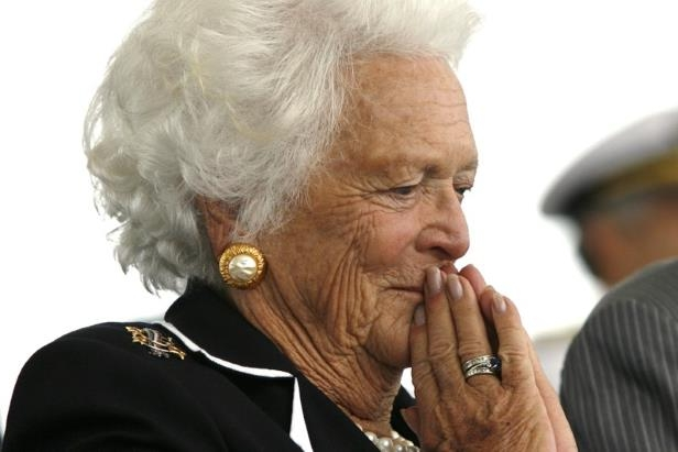 a man wearing a hat talking on a cell phone: FILE PHOTO: Former first lady Barbara Bush attends the christening ceremony of the USS George H.W. Bush in Virginia