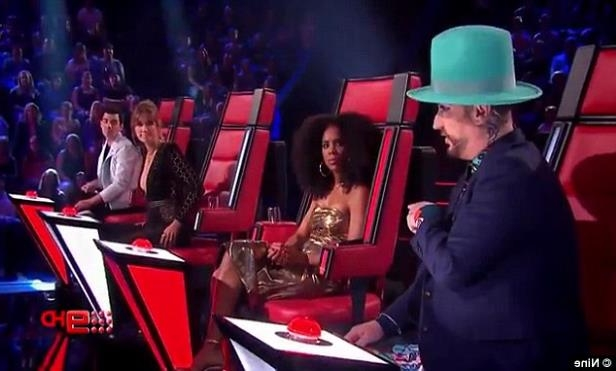 a person wearing a hat: Shade: Boy George tried to convince a contestant to choose him over Delta as a judge: 'You know that Delta's the Princess of Australia, you know that. But I'm famous all over the world'