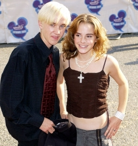 a woman posing for a picture: emma-watson-tom-felton-2003