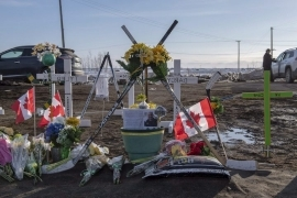 Hockey sticks, messages and other items continue to be added to a memorial at the intersection of a fatal bus crash that killed 16 members of the Humboldt Broncos hockey team.