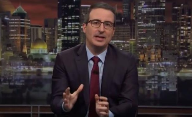 John Oliver wearing a suit and tie