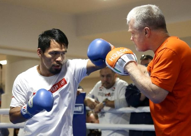 Manny Pacquiao (right) works out with his long-standing trainer Freddie Roach last year
