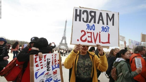 PARIS, FRANCE - MARCH 24: A large group of Americans and French hold a March for Our Lives anti-NRA anti-gun rally on Place de Trocadero, facing the Eiffel Tower, on March 24, 2018 in Paris, France. More than 800 March for Our Lives events, organized by survivors of the Parkland, Florida school shooting on February 14 that left 17 dead, are taking place around the world to call for legislative action to address school safety and gun violence. (Photo by Owen Franken - Corbis/Corbis via Getty Images) (Photo by Owen Franken - Corbis/Corbis via Getty Images)
