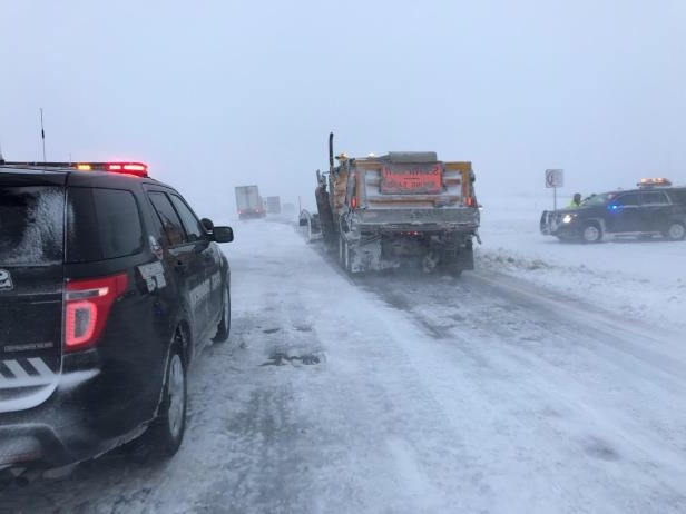 This photo provided by Nebraska State Patrol show stranded motorists on Interstate 80 near Sidney, Neb., Friday, April 13, 2018.  A potent spring storm system that's expected to persist through the weekend raked across the Midwest.  ( Nebraska State Patrol via AP)