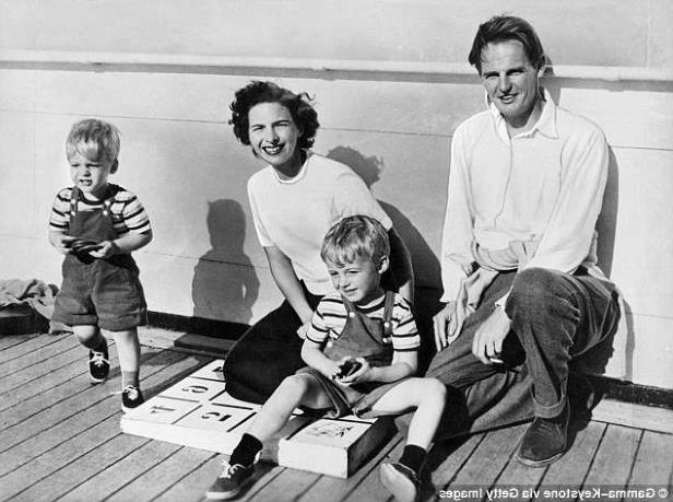 a group of people posing for a photo: Donald Maclean with his wife Melinda Marling and his two sons Ronald and Fergus in the 50s