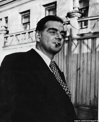 a man standing in front of a building: Kim Philby, the wily undercover master-spy who had recruited Maclean as a Soviet agent, briefed his fellow spy and Cambridge recruit, Guy Burgess (pictured), to warn Maclean that he was going to be rumbled any day, and to set up an escape plan