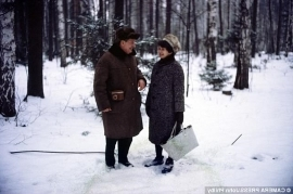 a man that is standing in the snow: Kim Philby with partner Melinda Maclean (who later returned to her husband and fellow spy, Donald Maclean) walk in the woods outside Moscow in the 1960's, photographed by his son John