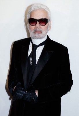 a man wearing a suit and sunglasses posing for the camera