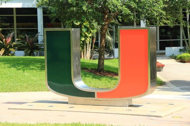 a sign on the side of the road: The University of Miami was vandalized with Swastikas in separate events.