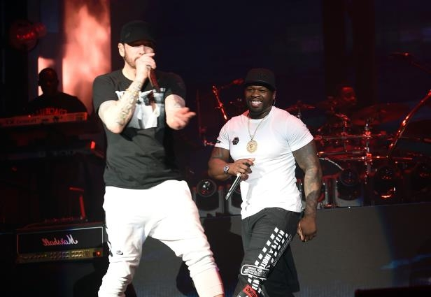 Curtis '50 Cent' Jackson (L) and Eminem perform onstage during Coachella 2018.