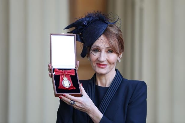 JK Rowling poses for pictures after she was made a Companion of Honour by Britain's Prince William during an Investiture ceremony at Buckingham Palace, in London December 12, 2017. REUTERS/Andrew Matthews/Pool