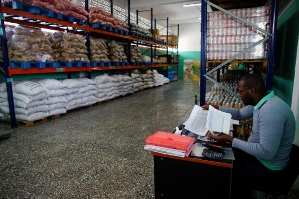 Tanelvy Borges, 33, works inside a newly opened wholesale outlet in Havana