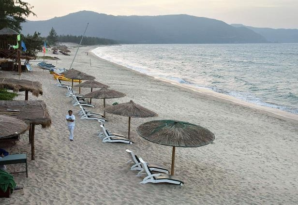 Umbrellas and beach chairs await tourists at a beach in Sanya in southern China's Hainan island.