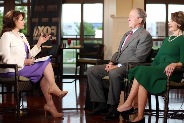 a group of people sitting on a bench: Former President George W. Bush and Laura Bush were interviewed by Maria Bartiromo on Wednesday. The former president said his mother and the former first lady, Barbara Bush, who died on Tuesday, would have wanted him to go ahead with the interview.