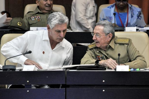 Cuban President Raul Castro (L) and First Vice president Miguel Diaz-Canel talking during the Permanent Working Committees of the National Assembly of the People's Power.  Cuba is preparing for the end of an era next week when Raul Castro steps down as president, ending his family's six-decade grip on power, and paving the way for a younger leader. But analysts say his replacement, expected to be 57-year-old Miguel Diaz-Canel -- currently Cuba's first vice president -- won't quite be alone at the helm of the communist island.