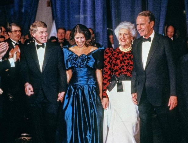 George H. W. Bush, Barbara Bush, Marilyn Quayle posing for a photo: US President-Elect George HW Bush, Barbara Bush, Marilyn Quayle, and Vice President-Elect Dan Quayle attend the Black Tie and Boots Inaugural Gala at the Washington Convention Center, Washington DC, January 18, 1989.