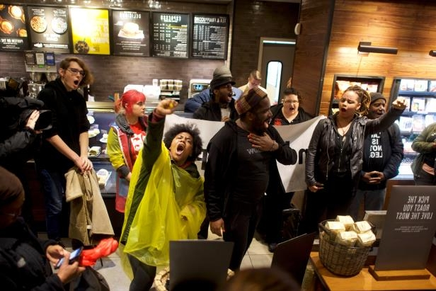 Protestors demonstrate inside a Center City Starbucks, where two black men were arrested, in Philadelphia, Pennsylvania, U.S., April 16, 2018.