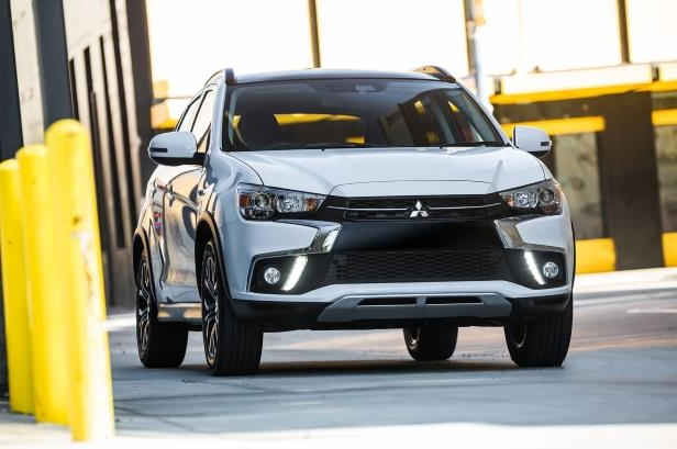 Slide 1 of 16: 2018-Mitsubishi-Outlander-Sport-front-three-quarter-03-1.jpg