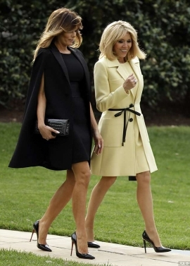 a woman standing in the grass: Fashionistas: Melania Trump and France's first lady Brigitte Macron put on a stylish display at the White House on Monday evening