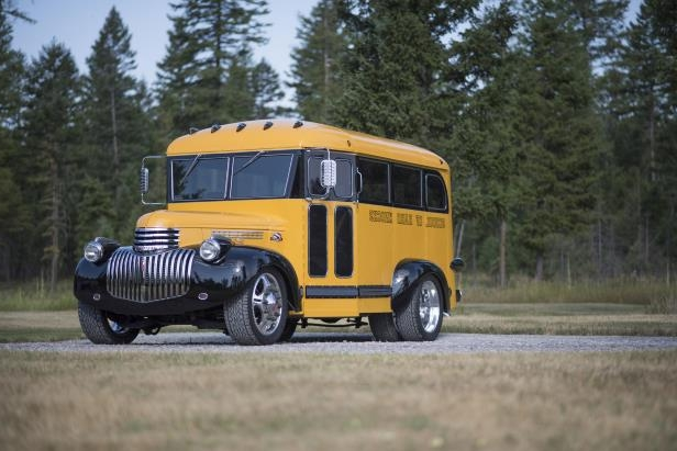 a yellow school bus driving down a dirt road: 001 1941 Chevrolet Magic Bus Frontwide