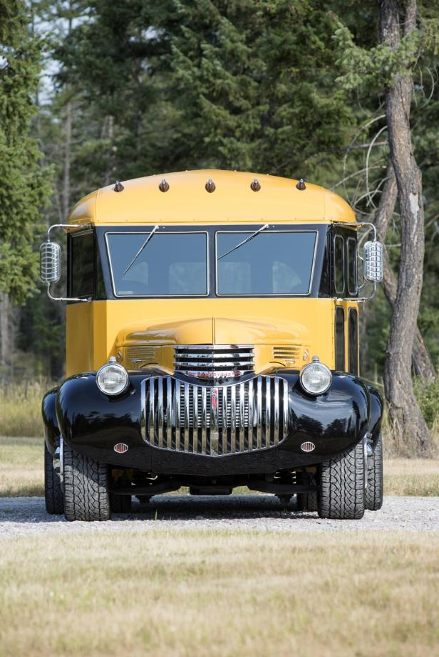 a yellow school bus parked in a forest: 002 1941 Chevrolet Magic Bus Hedon