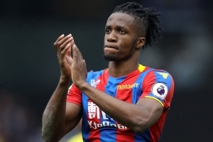 Hodgson admits Wilfried Zaha has an uncertain future