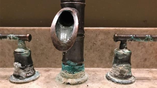 A corroded faucet at a home in The Oaks subdivision