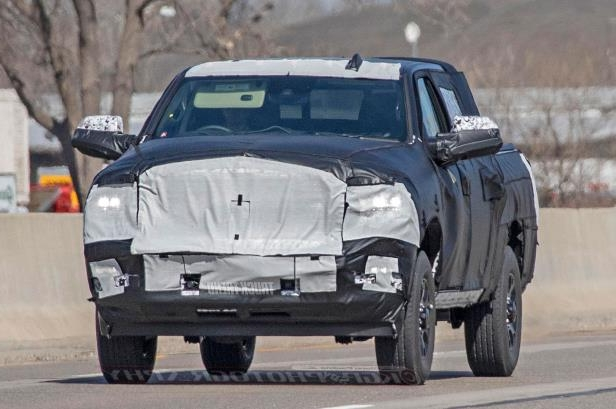 a black truck sitting on top of a car: 2020 Ram 2500 Hd Front Quarter 07
