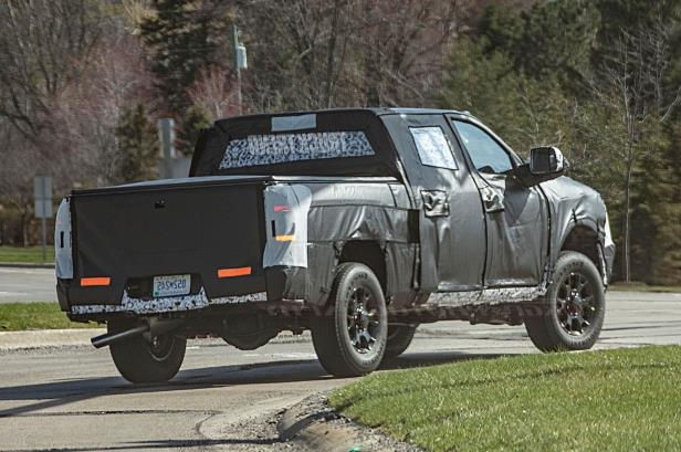 a truck that is driving down the road: 2020 Ram 2500 Hd Rear Quarter 03