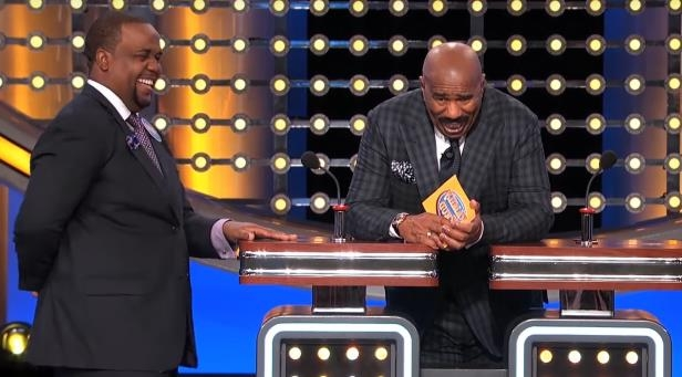 Steve Harvey wearing a suit and tie: YouTube/Family Feud