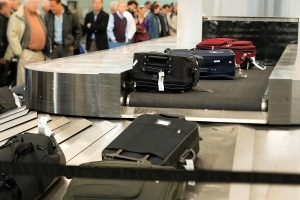 Travelers paid airlines a record $4.6 billion last year to check their luggage