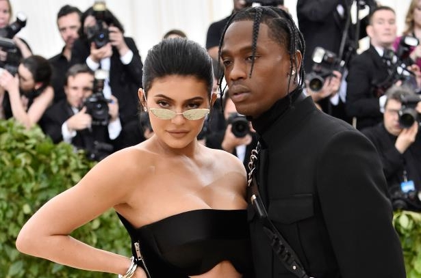 a group of people standing in front of a crowd posing for the camera: Kylie Jenner Travis Scott
